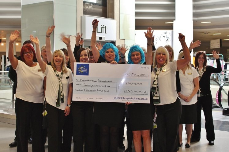 Staff from Marks and Spencer Meadowhall, carrying a cheque for more than £26,000 for Sheffield Hospitals Charity